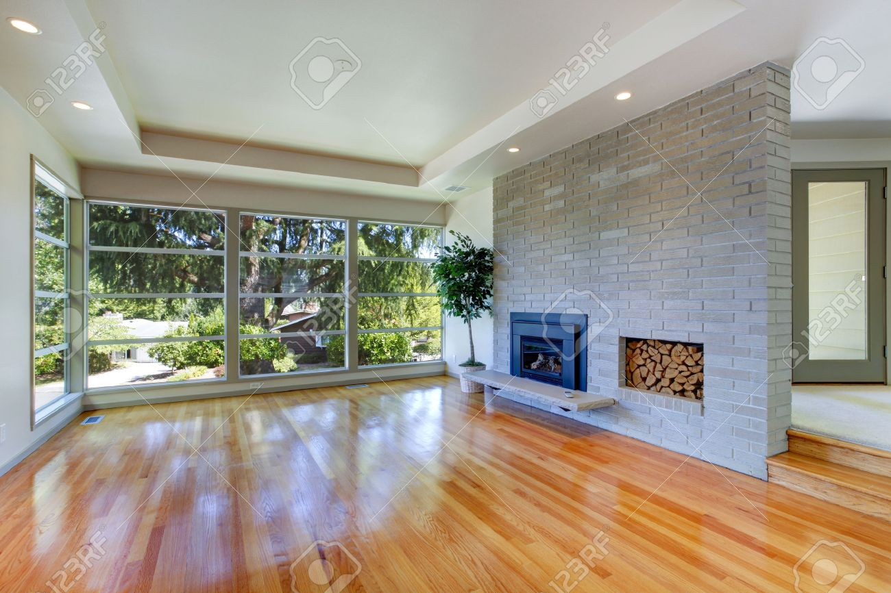Empty House Interior Living Room With Glass Wall View Of Brick Fireplace Stock Photo