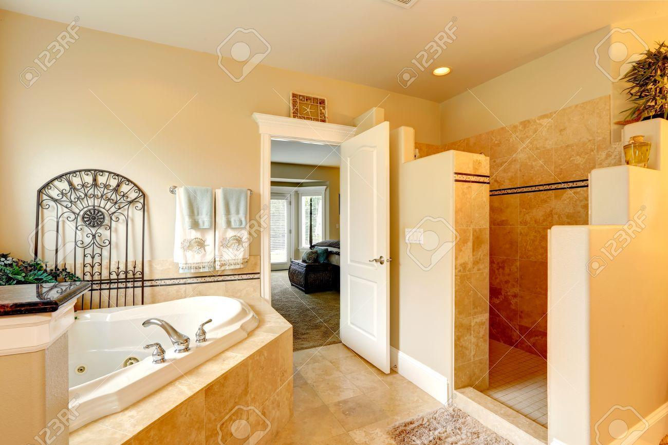 Luxury bathroom in master bedroom. Bathroom has a whirlpool tub..