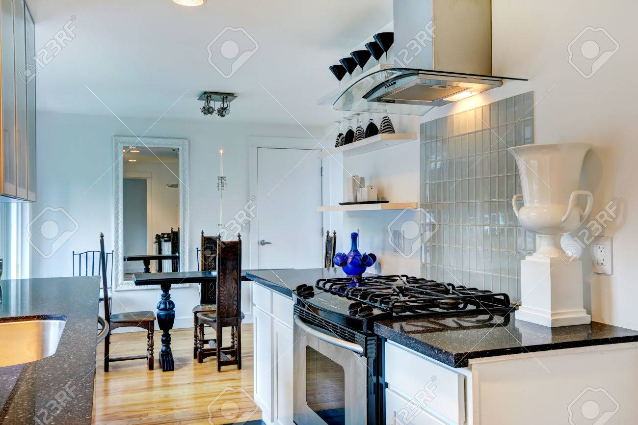 White Kitchen Room With Black Granite Tops. View Of Carved Wood ...