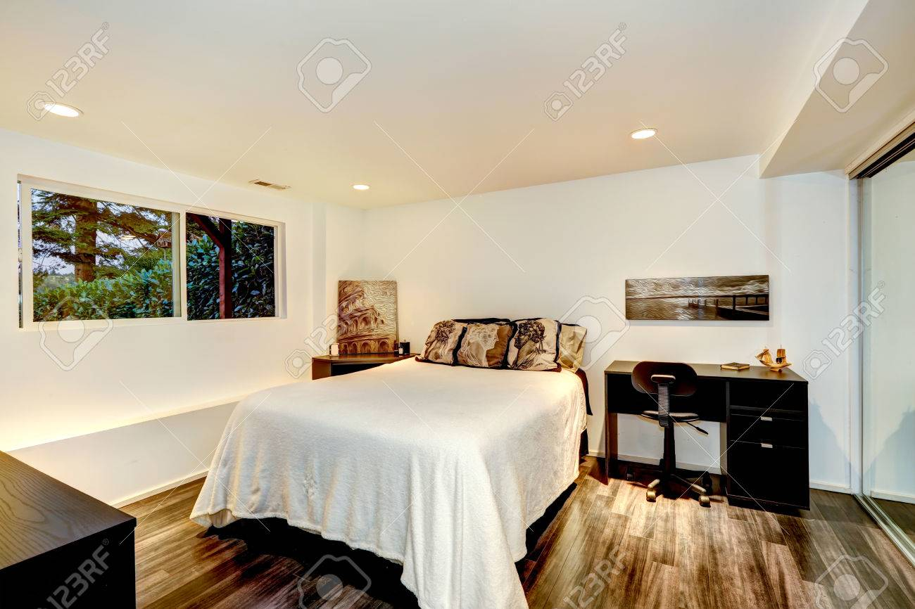 White Bedroom Interior With Dark Hardwood Floor And Office Area Stock Photo Picture And Royalty Free Image Image 30761232