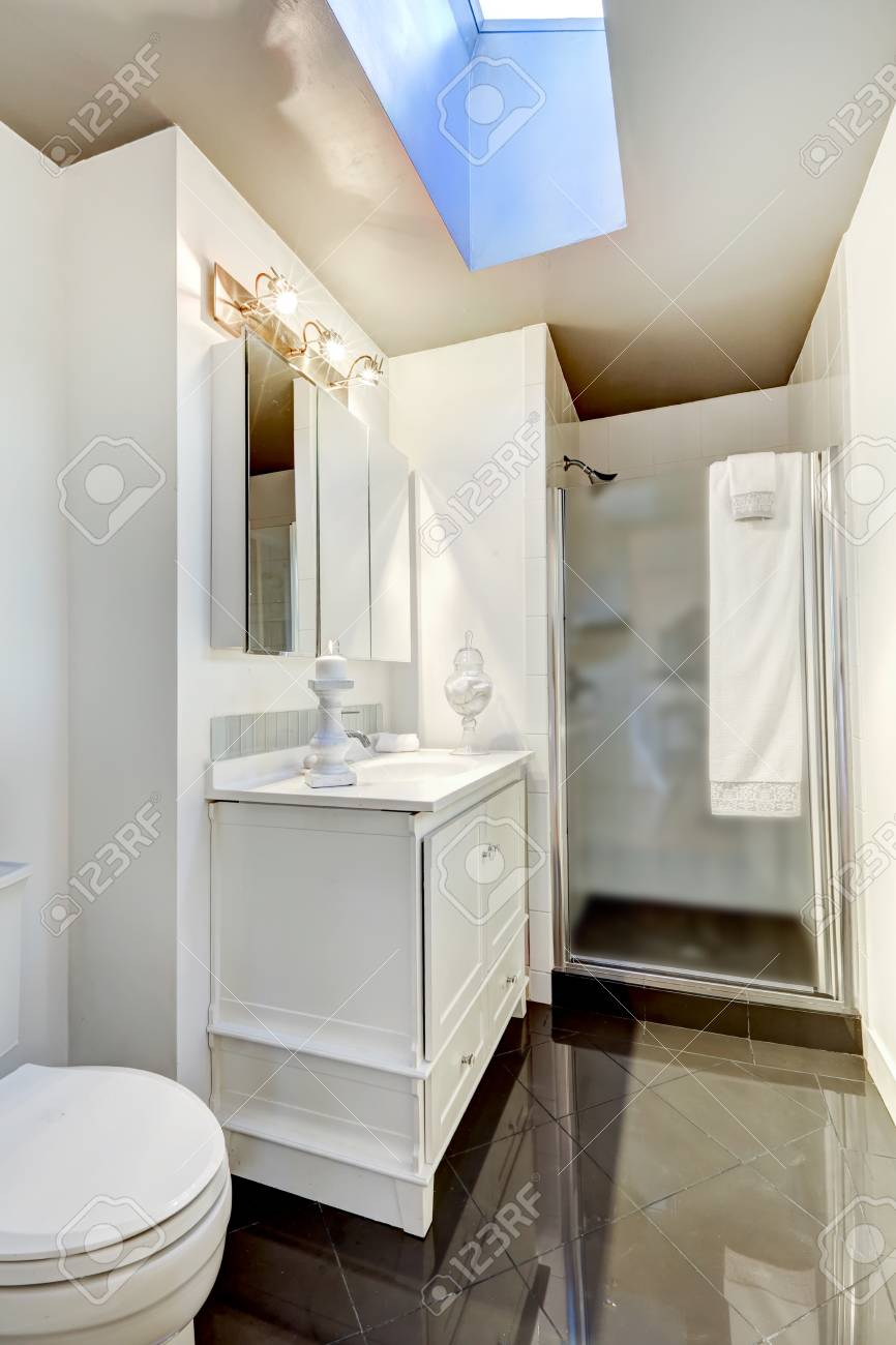 White Simple Bathroom Interior With Glass Door Shower And Small
