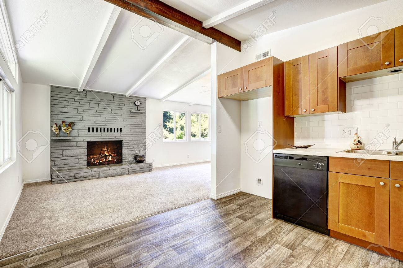 Kitchen Cabinets With Black Appliances And White Tile Wall Trim