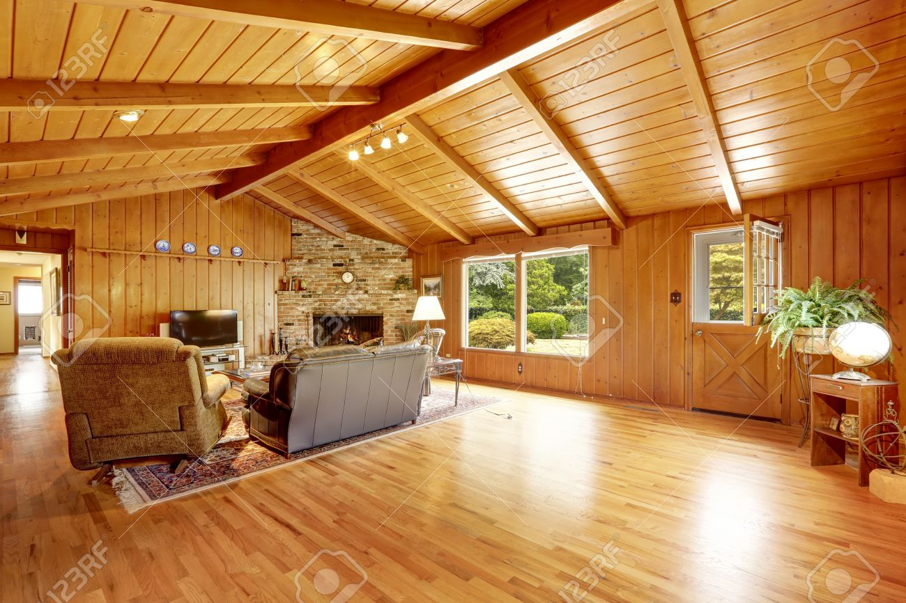 vaulted ceiling living room. Log cabin house interior with vaulted ceiling  Living room fireplace and leather couch Stock Cabin House Interior With Vaulted Ceiling Room