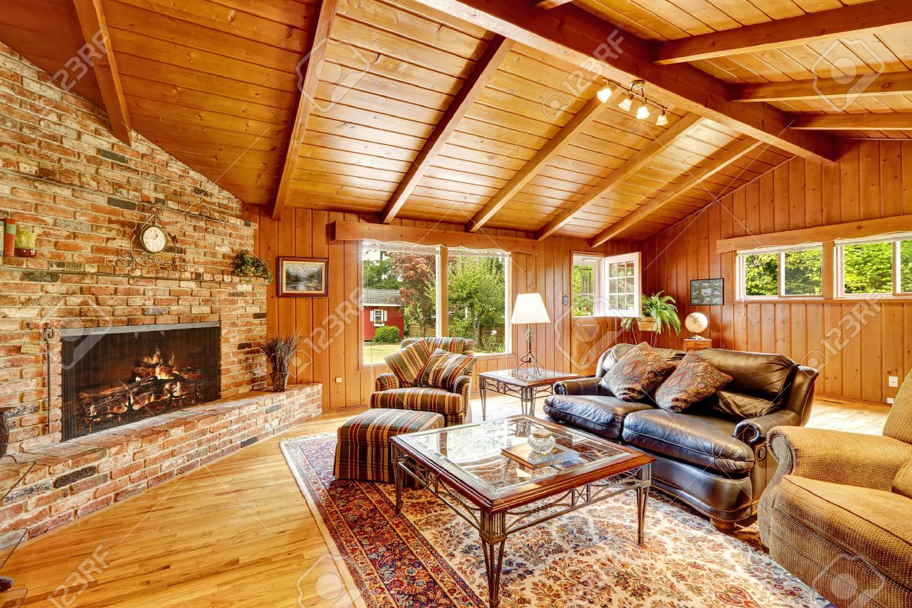 Log Cabin House Interior With Vaulted Ceiling. Luxury Living Room With  Fireplace, Leather Couch