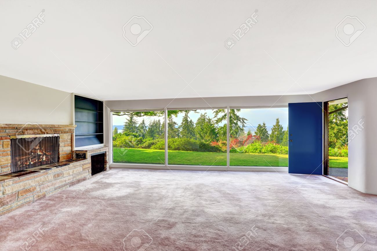 Spacious Empty Living Room With Panorama Windows. Overlooking Beautiful  Water View Of Puget Sound.