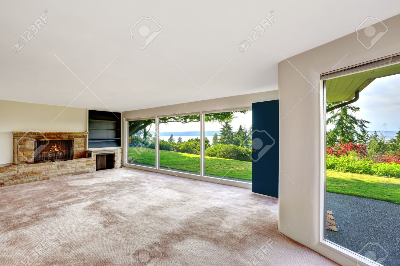 spacious empty living room with panorama windows overlooking