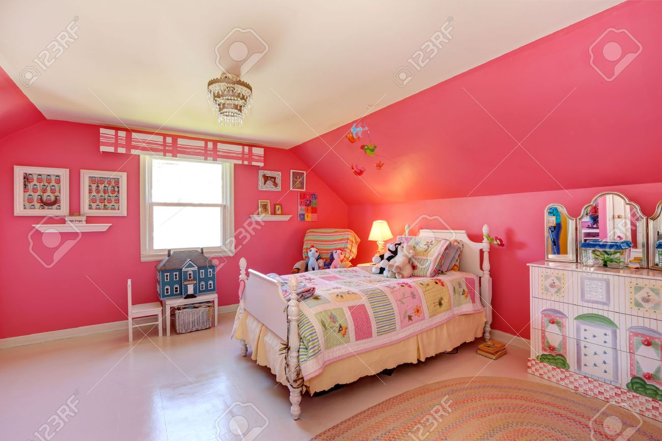 Beautiful Girls Room In Bright Pink Color With Carved Wood Bed And Toys  Stock Photo