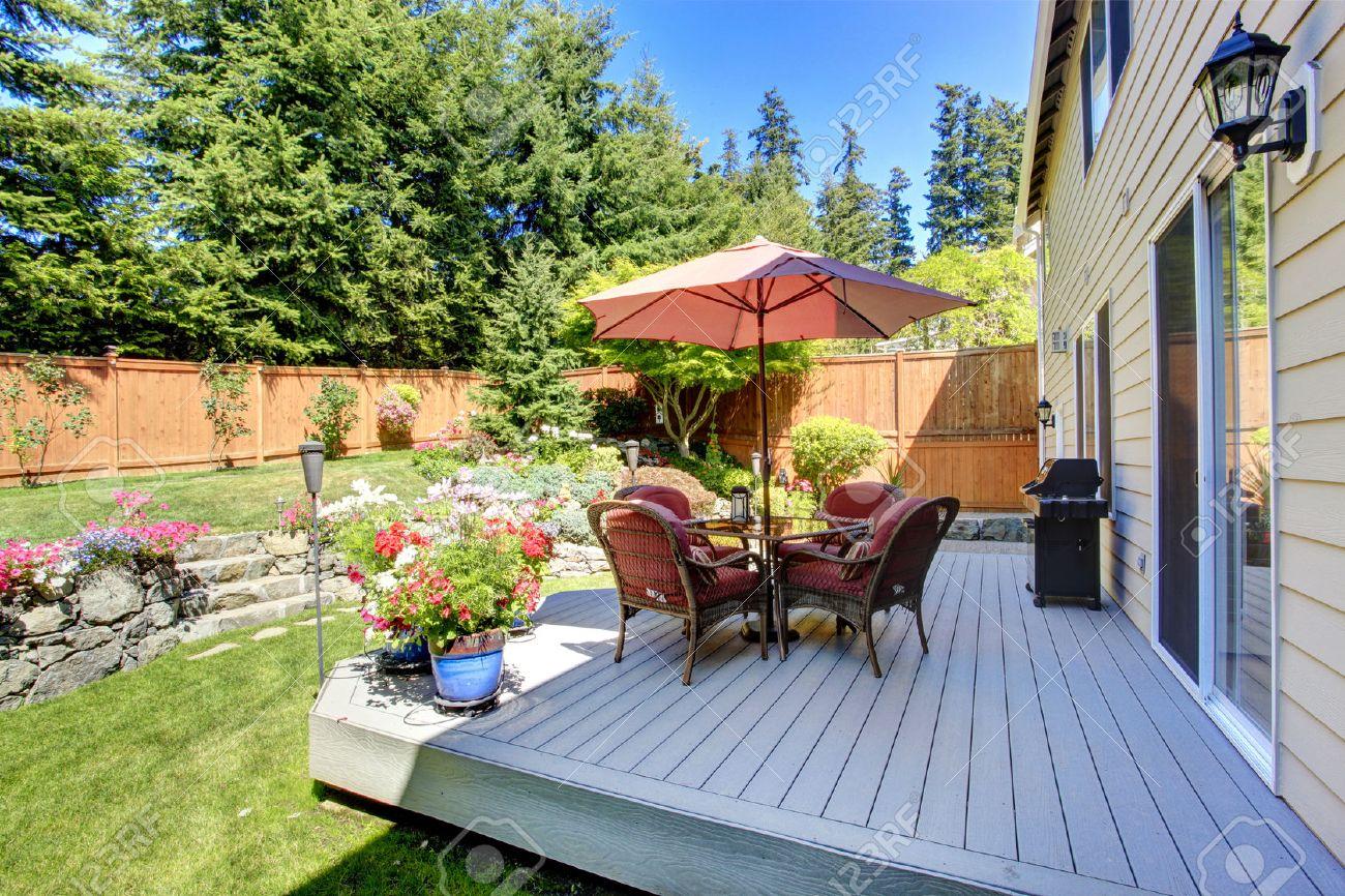 beautiful landscape design for backyard garden and patio area on walkout deck stock photo 31001003 - Hinterhoflandschaften Designs