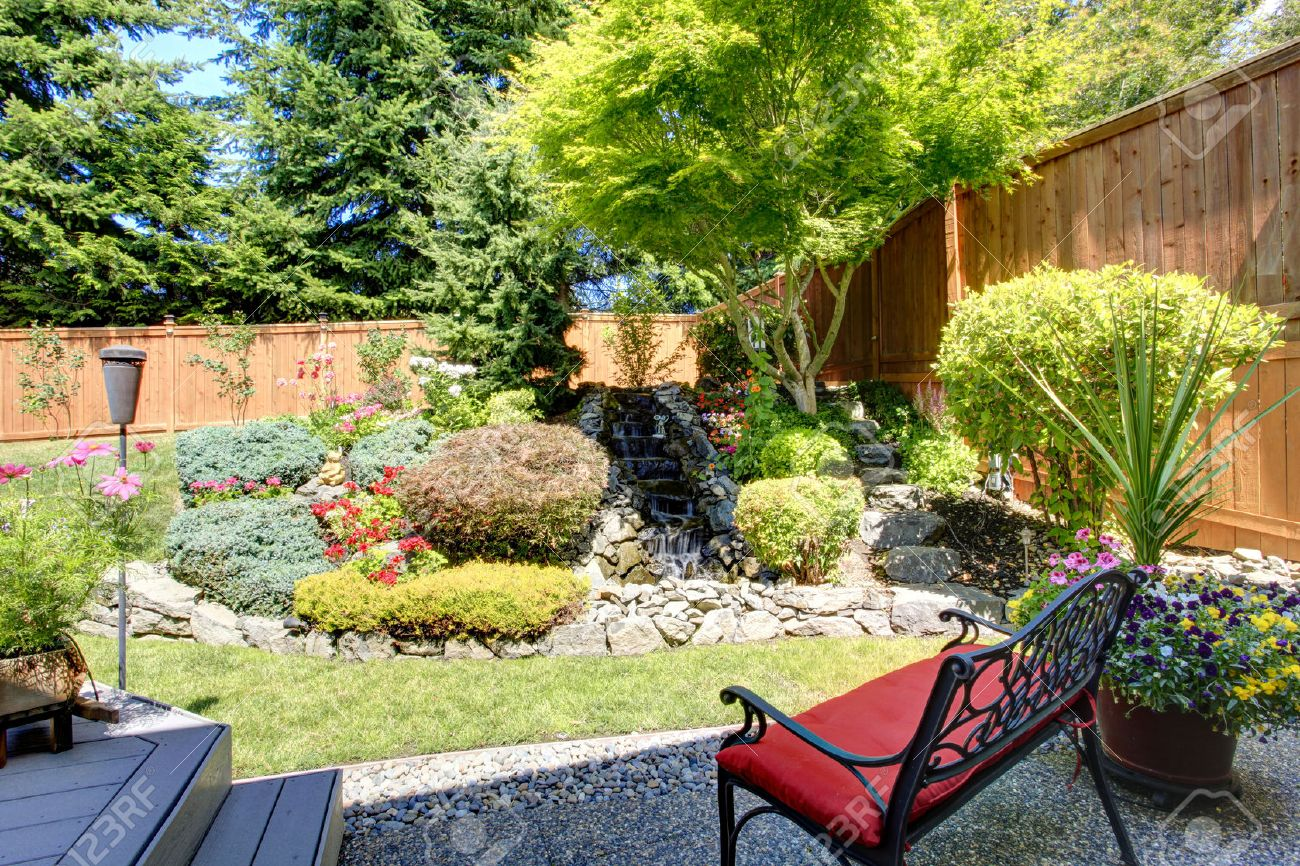 Exceptionnel Beautiful Landscape Design For Backyard Garden With Small Bench Stock Photo    31001004