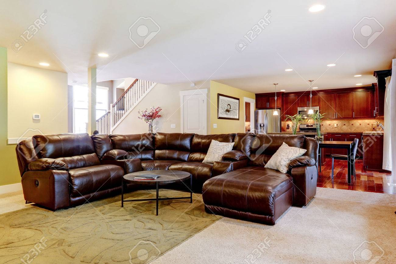house interior with open floor plan. living room with leather