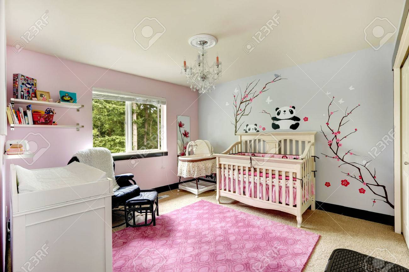 Nursery Room Interior In Light Blue And Pink Colors With Painted