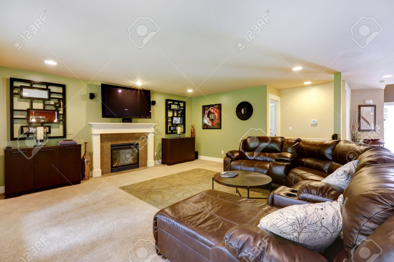 Light Green Living Room Light Green Living Room With Fireplace Tv And Leather Couch Stock
