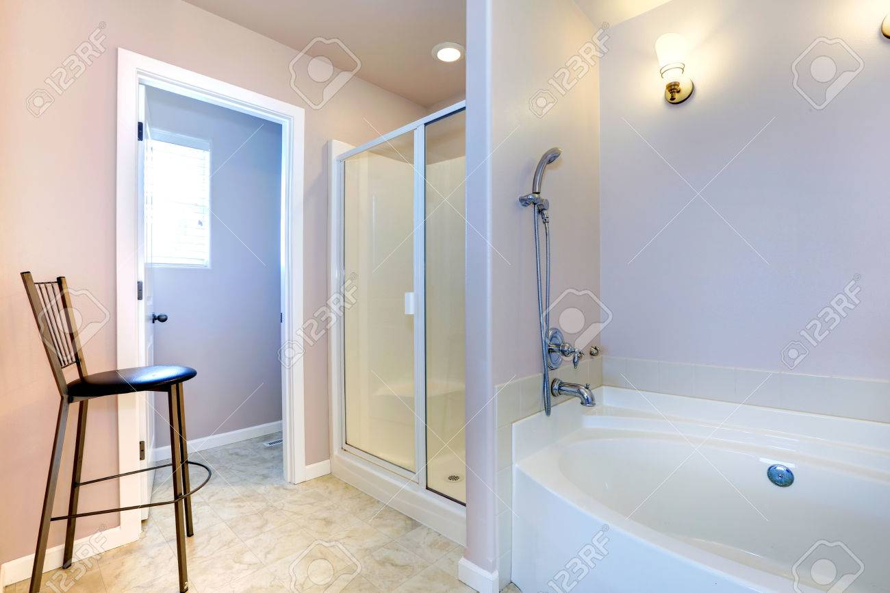 Refreshing Light Lavender Bathroom With White Bath Tub, Glass ...