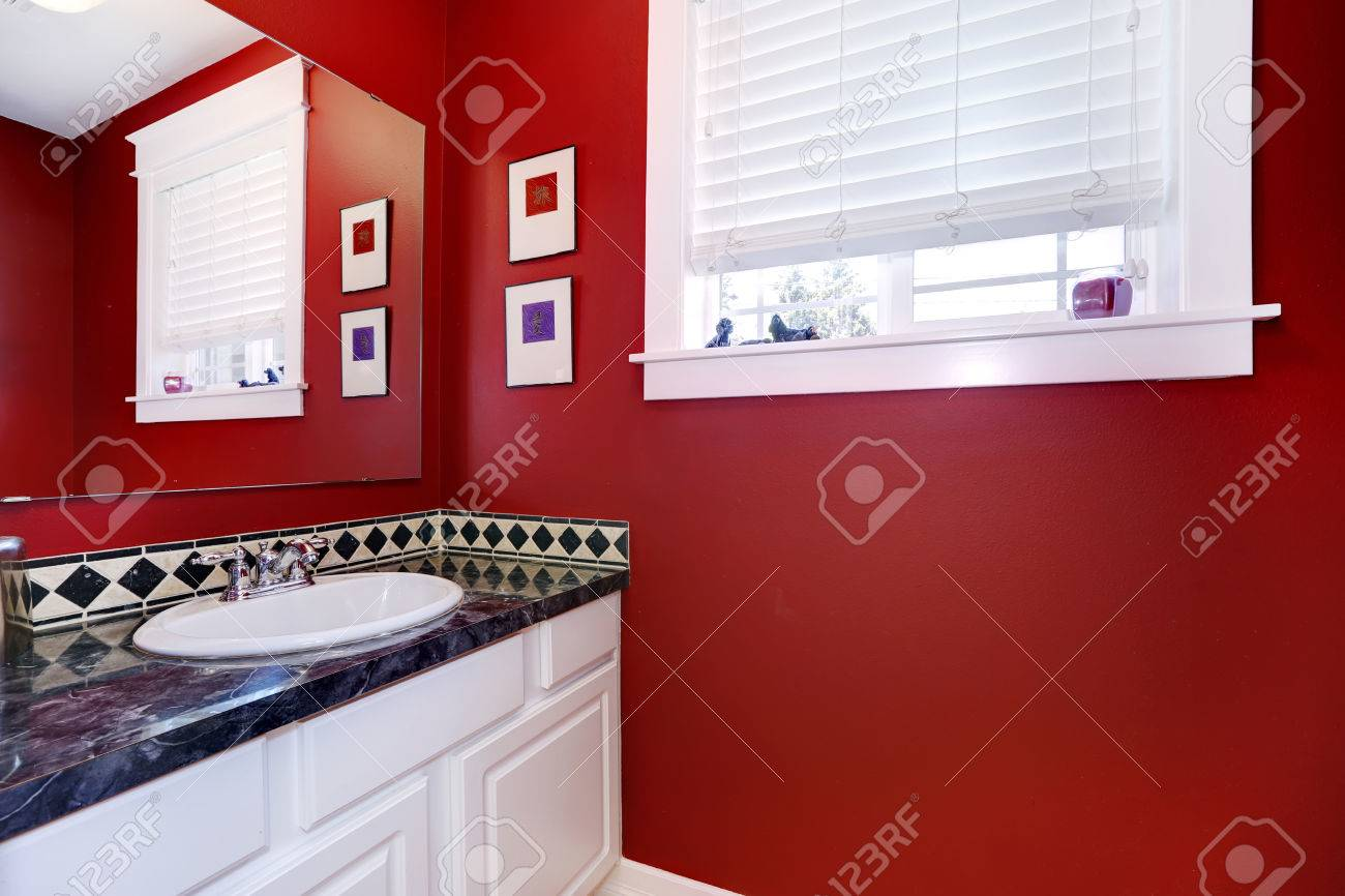 Bathroom Interior With Bright Red Walls And White Vanity Cabinet Stock Photo Picture And Royalty Free Image Image 31085226