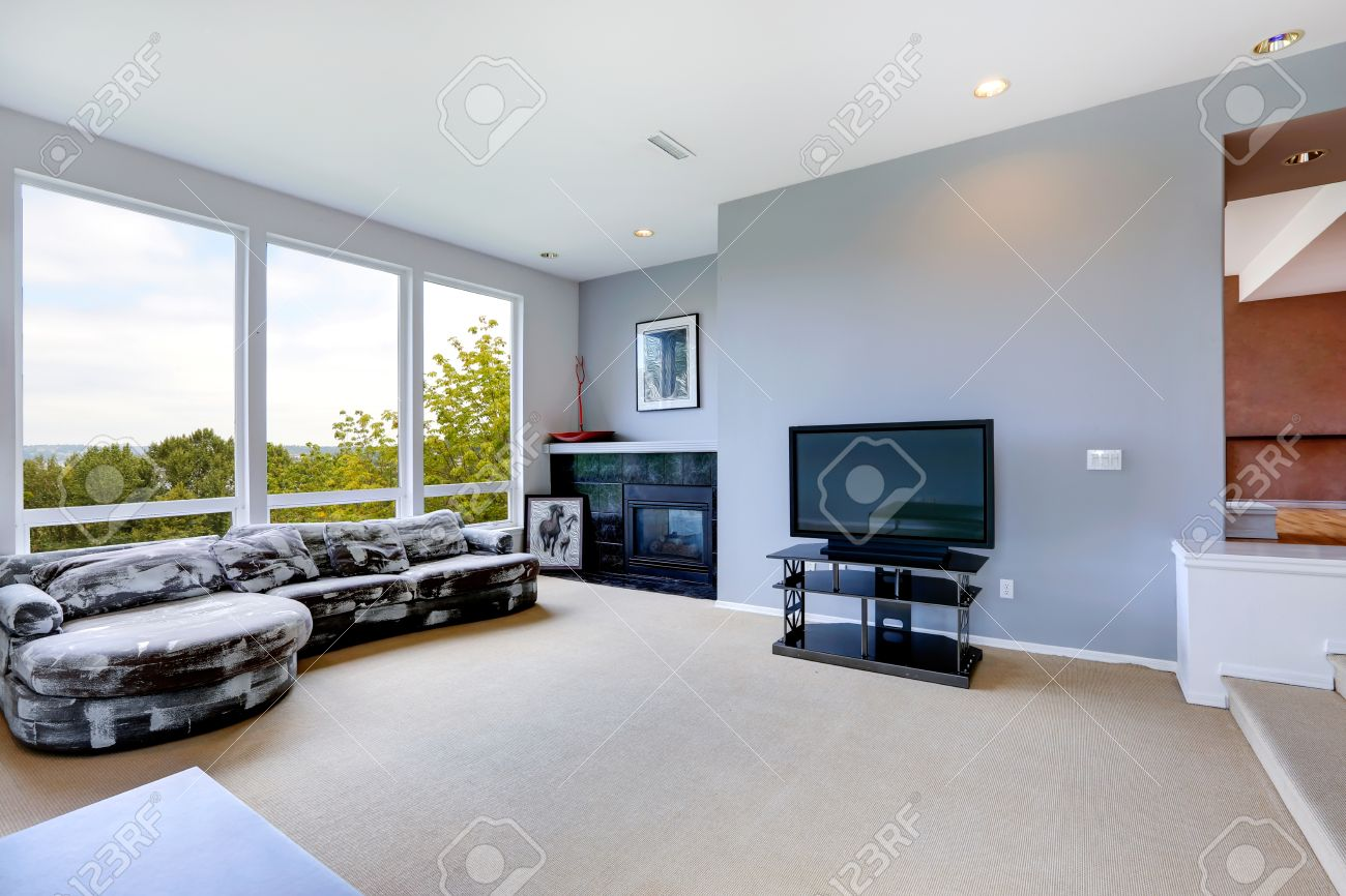 living room with tv and fireplace. Light Blue Living Room Interior With Tv, Fireplace And White Black Couch Stock Photo Tv