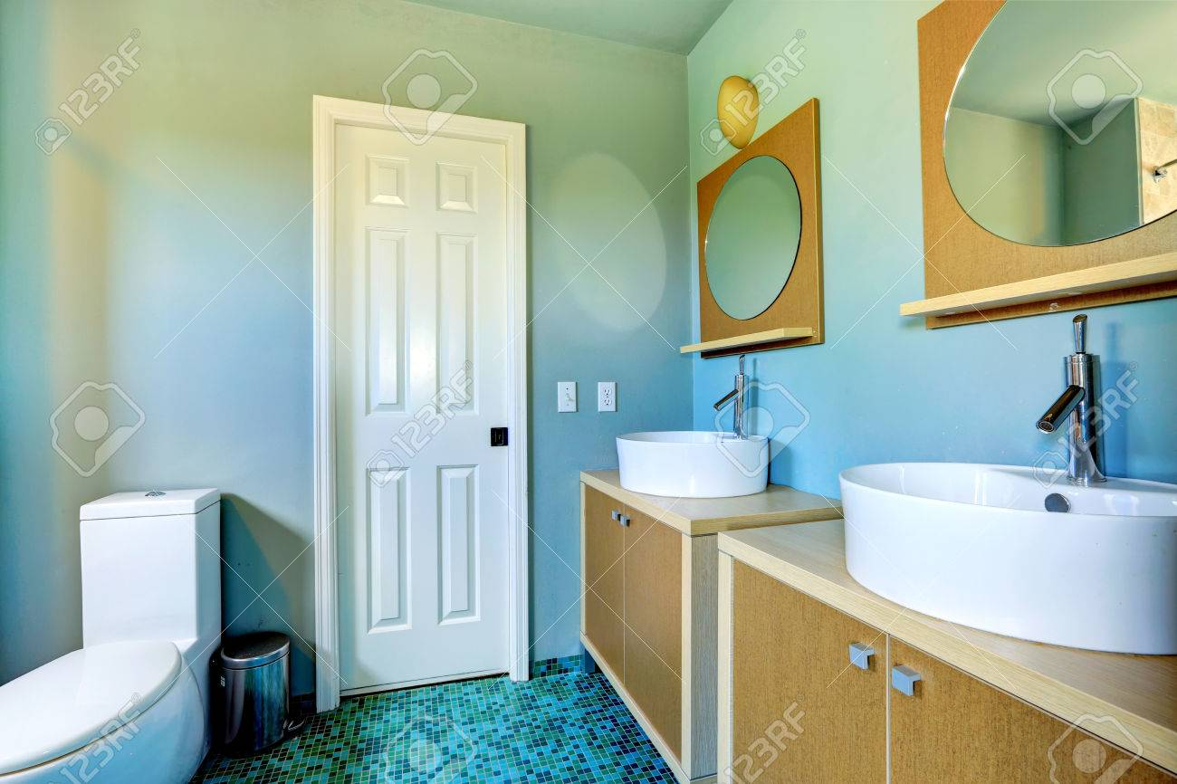 Light Blue Bathroom Interior With Modern Vanity Cabinets With Stock Photo Picture And Royalty Free Image Image 31087913