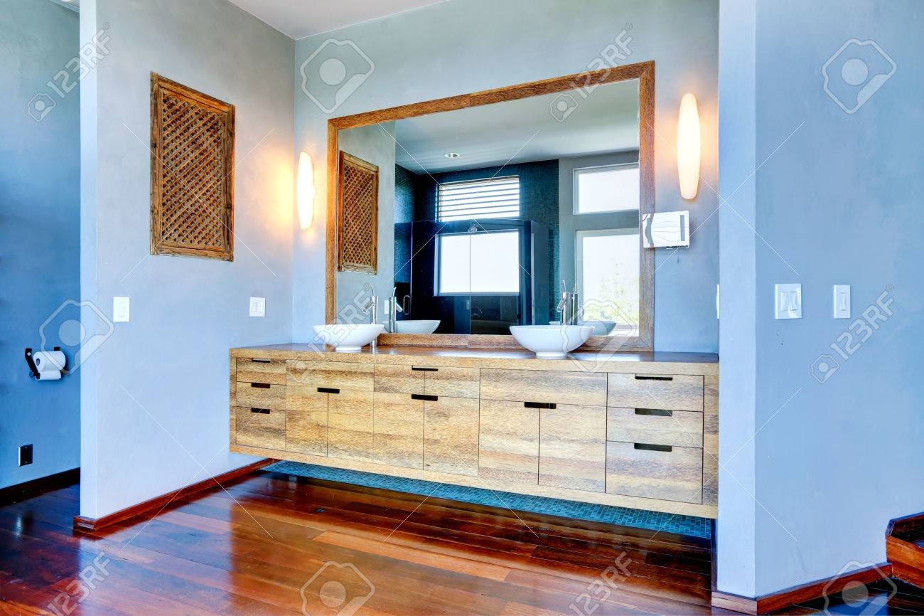 Light Blue Bathroom Interior. View Of Wooden Cabinet With Vessel ...