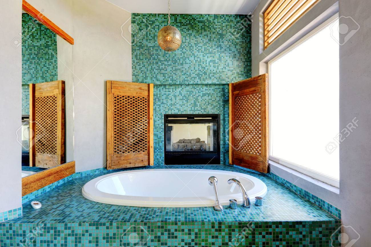 Bathroom With Turquoise Tile Trim And Fireplace Stock Photo, Picture ...