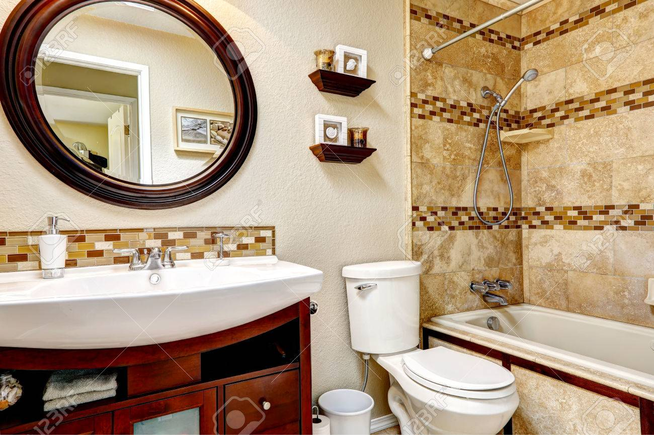 Light Tones Bathroom With Tile Wall Trim Wooden Vanity Cabinet Stock Photo Picture And Royalty Free Image Image 31273644