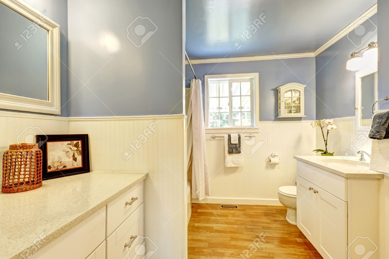 Bright Bathroom With Lavender And White Wall Trim With Honey.. Stock ...