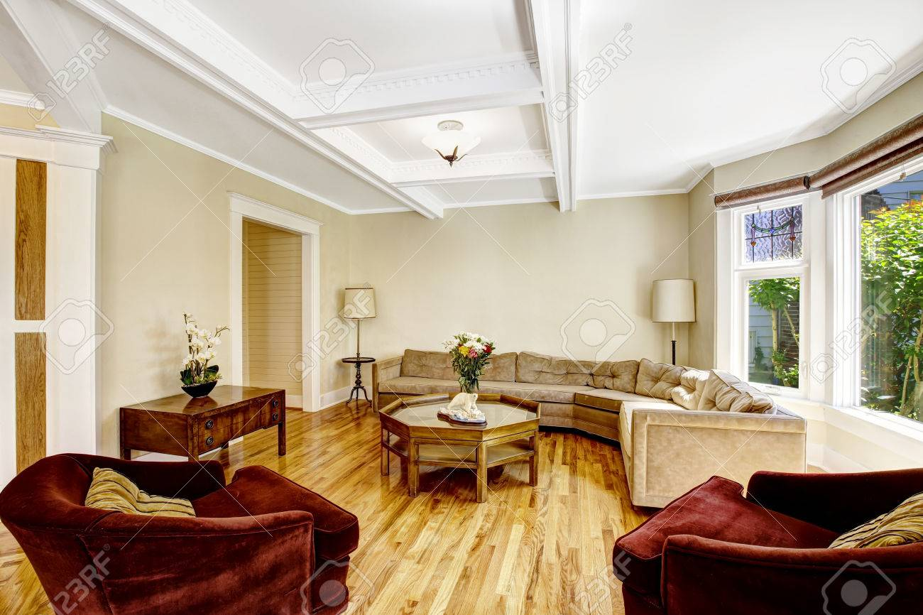 Bright Living Room With Coffered Ceiling System, Hardwood Floor ...