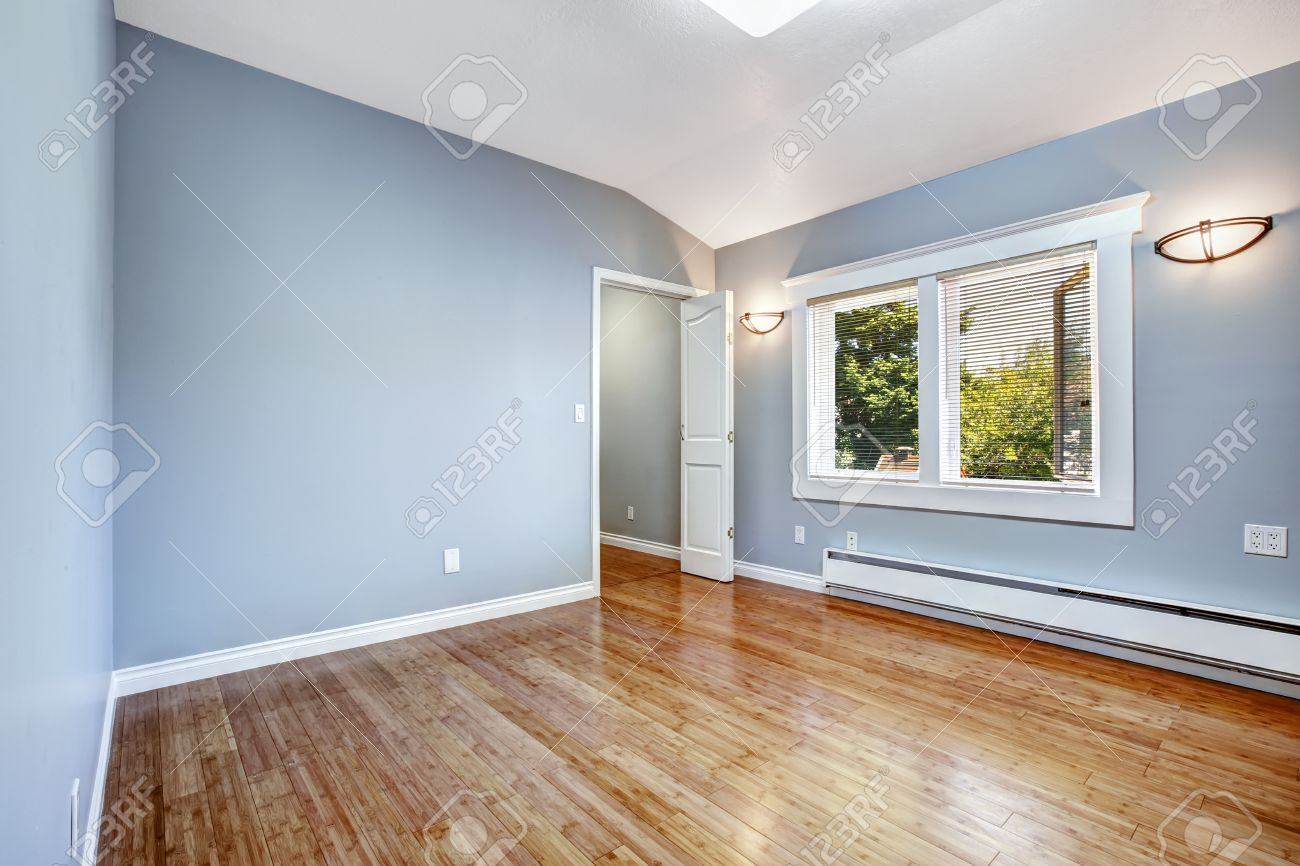 Pleasing Empty Bedroom With Light Blue Walls And New Hardwood Floor Home Remodeling Inspirations Genioncuboardxyz