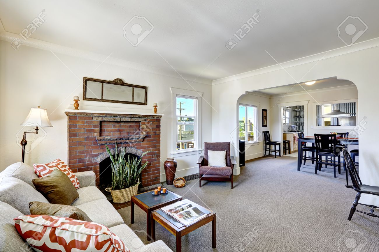 simple room with brick fireplace and beige carpet floor dining