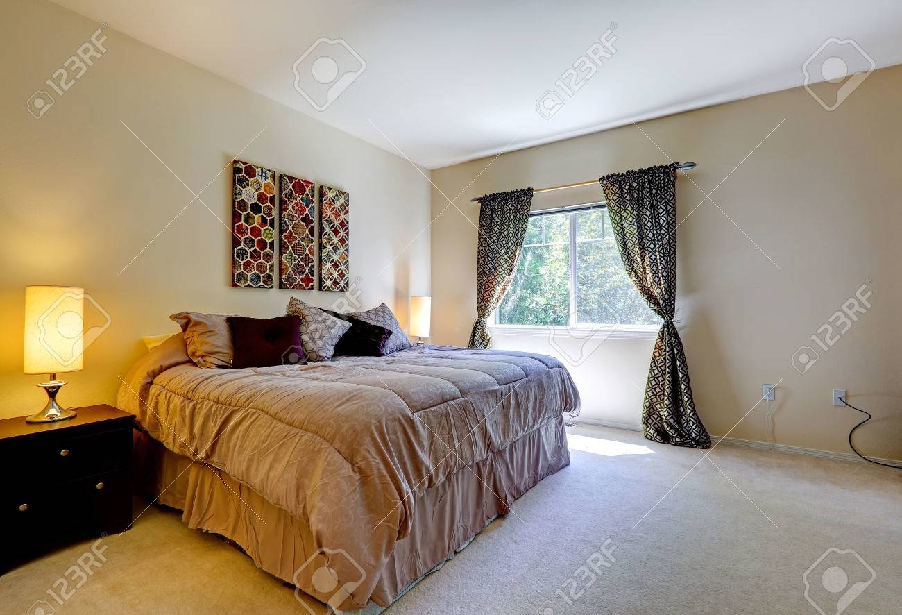 Cozy Bedroom With Window Black Curtains And Light Brown Bed Stock Photo