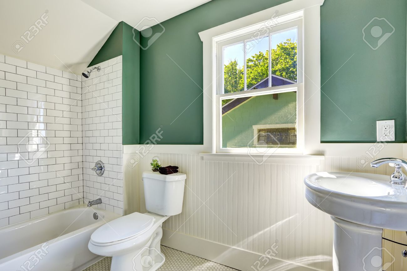Green and white bathroom - Stock Photo White Bathroom Interior With Green Walls With Siding And Tile Wall Trim