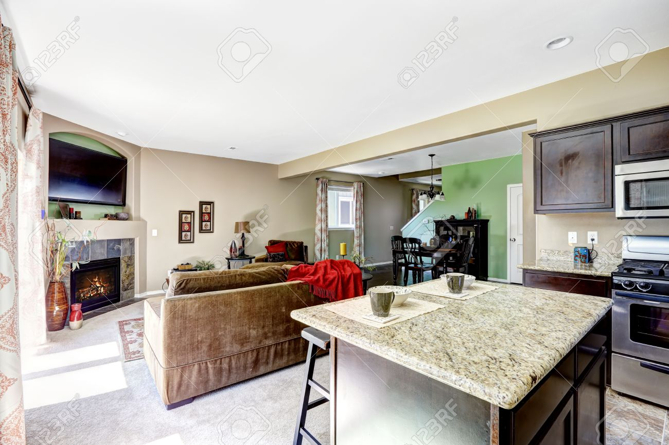 Kitchen Island Open To Living Room house interior with open floor plan. view of kitchen island with