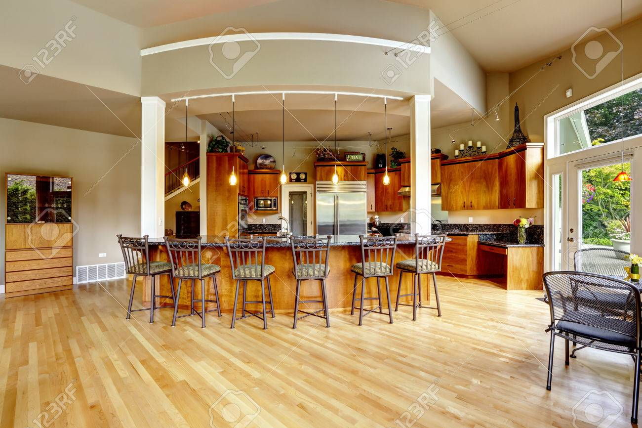 spacious luxury kitchen room with columns and round granite spacious luxury kitchen room with columns and round granite counter top with stools stock photo