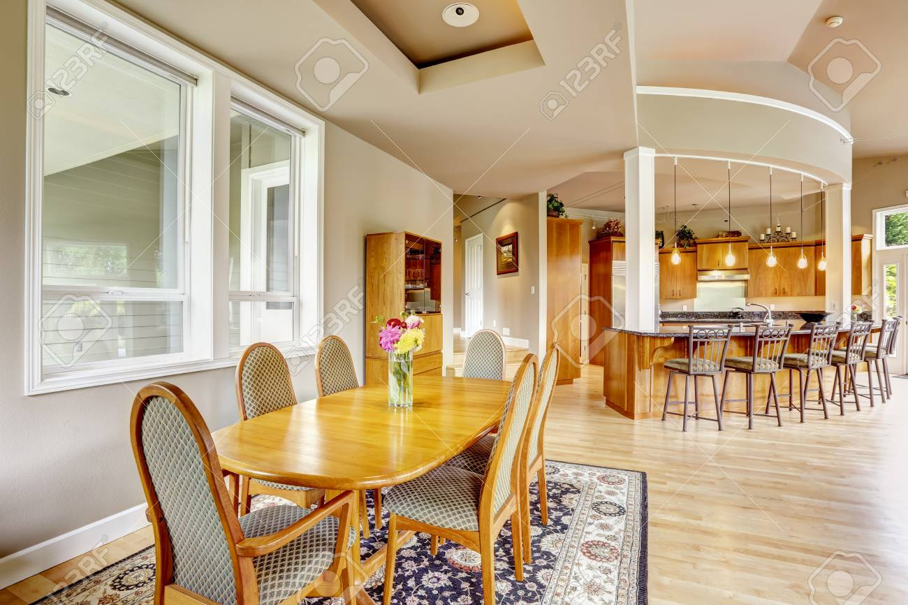Spacious Luxury Kitchen Room With Columns And Round Granite Counter - Granite countertop dining table