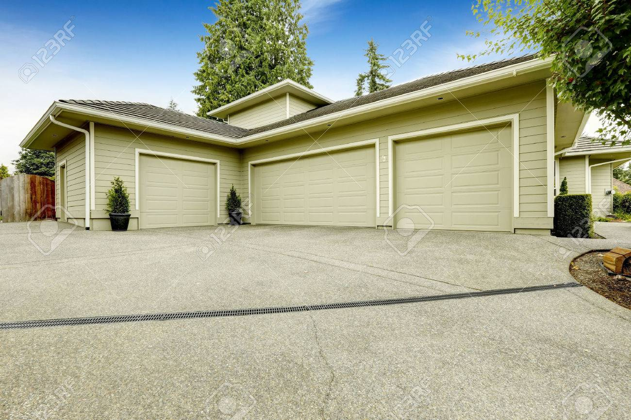 one story house with three car garage and driveway stock photo