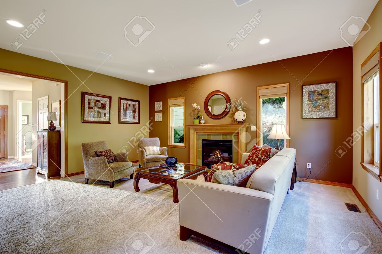 Living Room With Brown And Mustard Walls Furnished With Couch