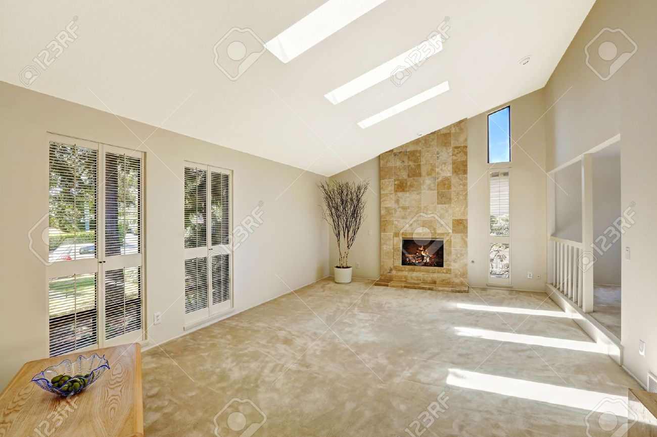 Floor Plan In Empty House. Beautiful Living Room With Fireplace, Vaulted  Ceiling And Skylights