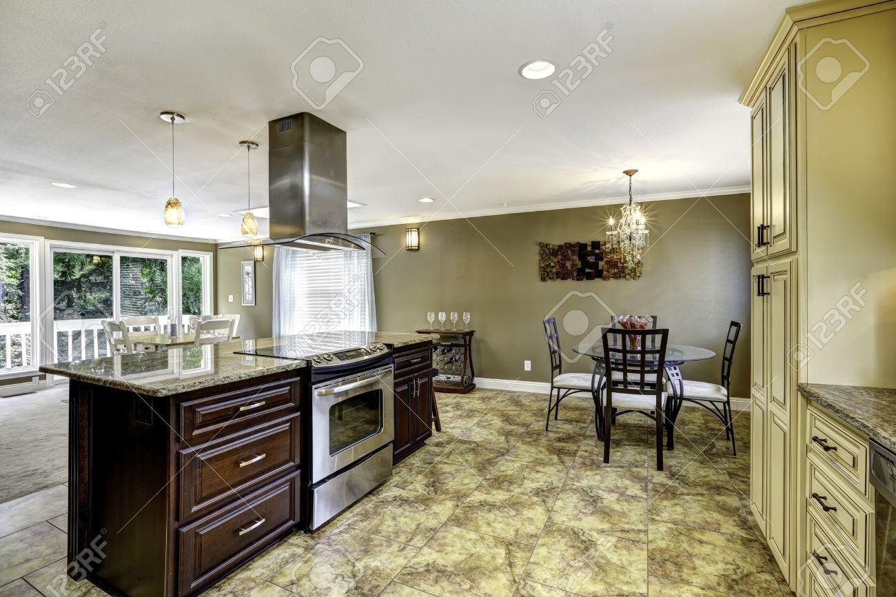 Spacious Kitchen Room With Tile Floor. Big Kitchen Island With ...