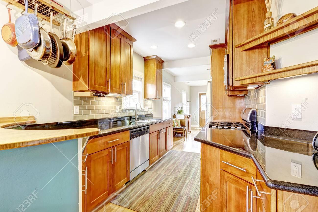 Bright Brown Kitchen Cabinets With Black Granite Tops. Kitchen ...