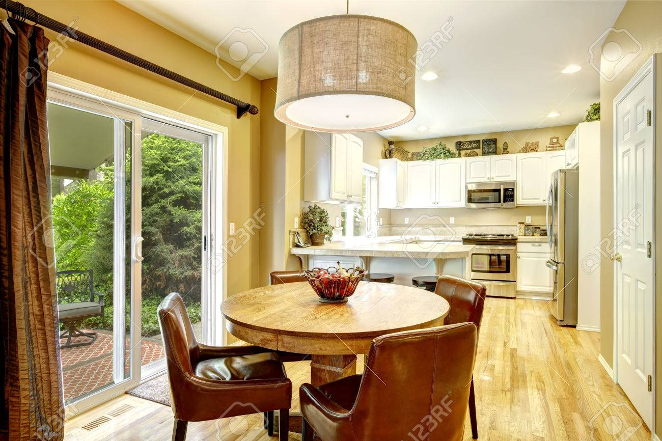Fabulous White Kitchen Room With Round Wood Dining Table Brown Leather Pdpeps Interior Chair Design Pdpepsorg