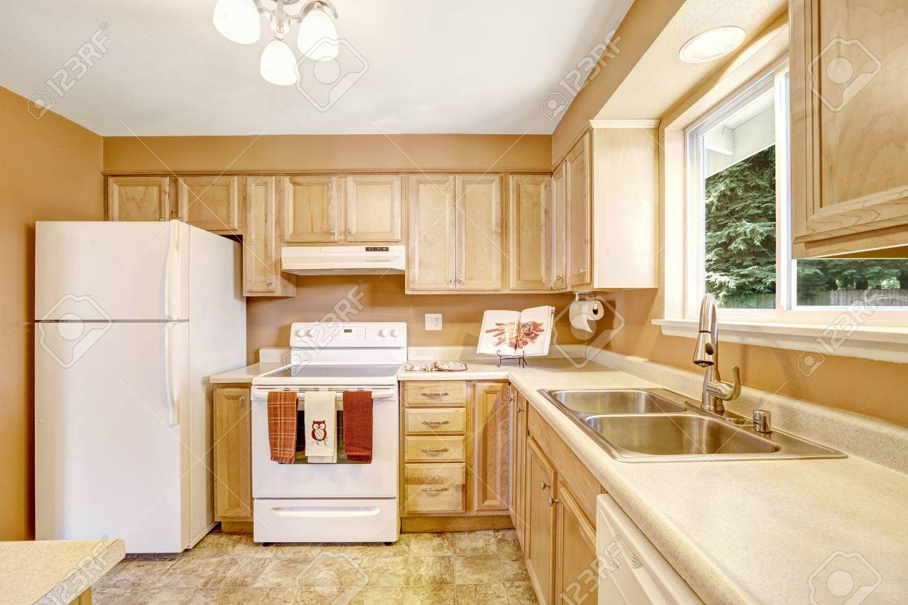 New Wooden Kitchen Cabinets In Light Tones With White Appliances Stock Photo Picture And Royalty Free Image Image 31616101