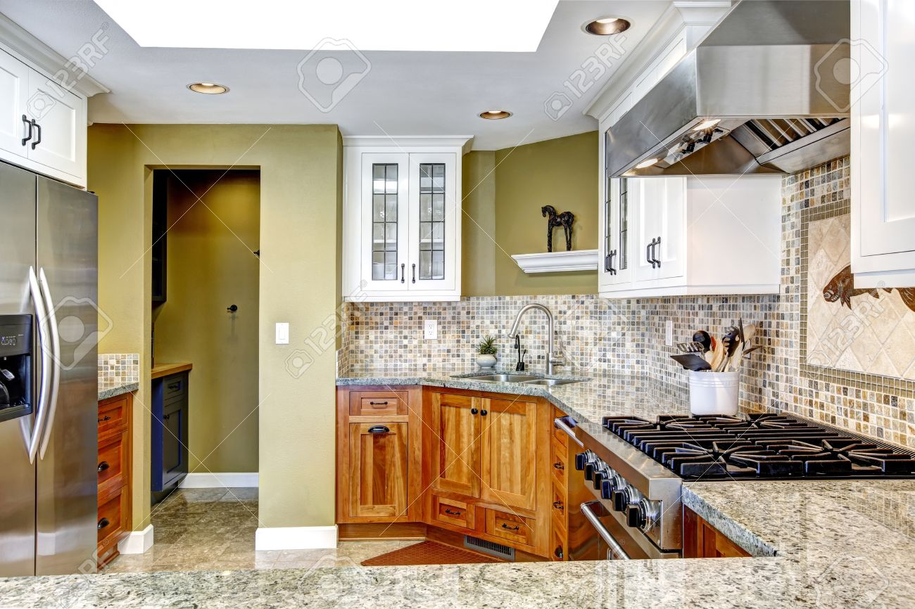 - Modern House Interior. White And Brown Kitchen Room With Shiny