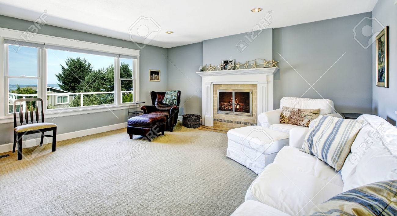 Light Blue Living Room With White Sofa, Armchair And Leather.. Stock ...