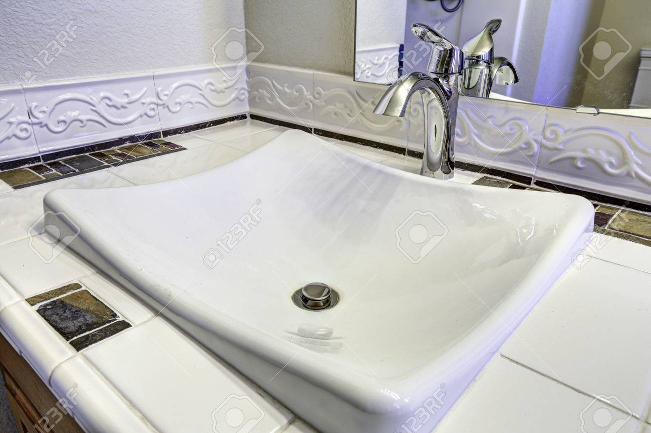Bathroom With White Sink With Steel Faucet. Tile Counter Top Stock ...