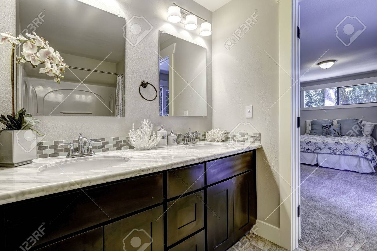 Decorated Bathroom Vanity Cabinet With Mirrors In Master Bedroom