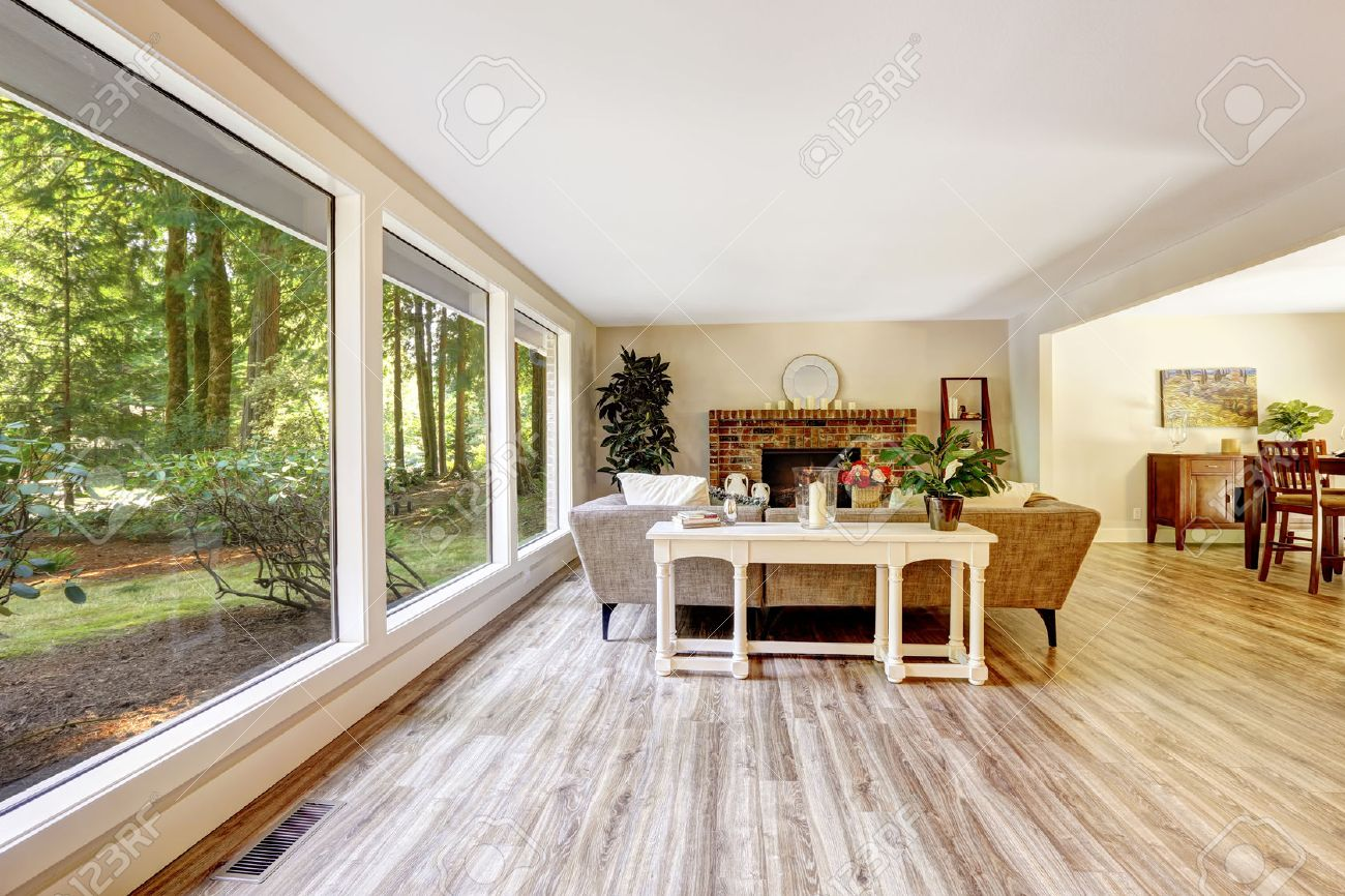 Spacious Bright Living Room With Brick Fireplace, Couch, White Table And Glass  Wall Stock Part 90