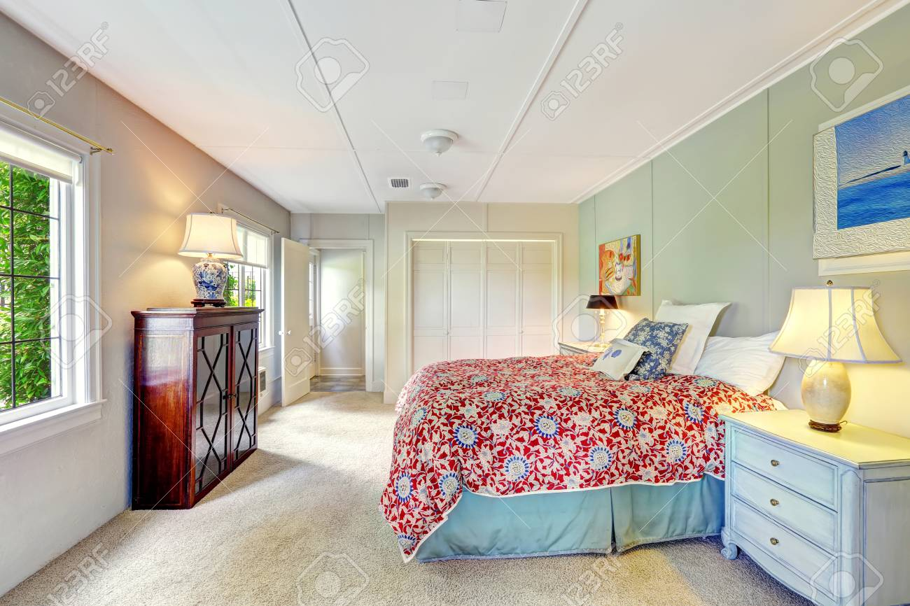 Bright Simple Bedroom Interior With Colorful Bedding Old Nightstand