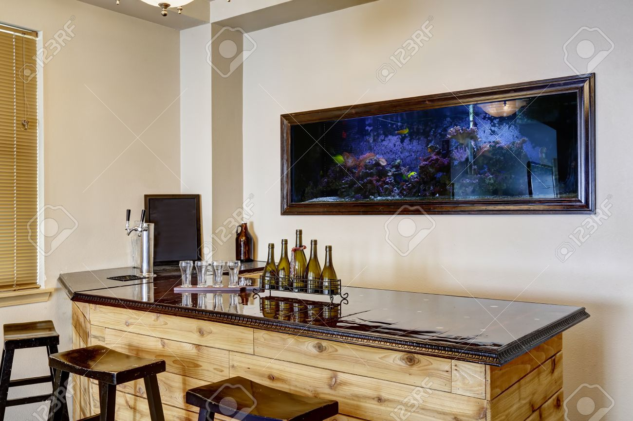 Soft Ivory Bar Room With Built In The Wall Aquarium. Wooden Cabinet ...