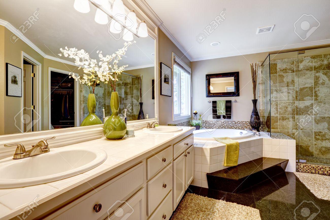 Luxury Bathroom Interior With Corner Bath Tub And Glass Door.. Stock ...