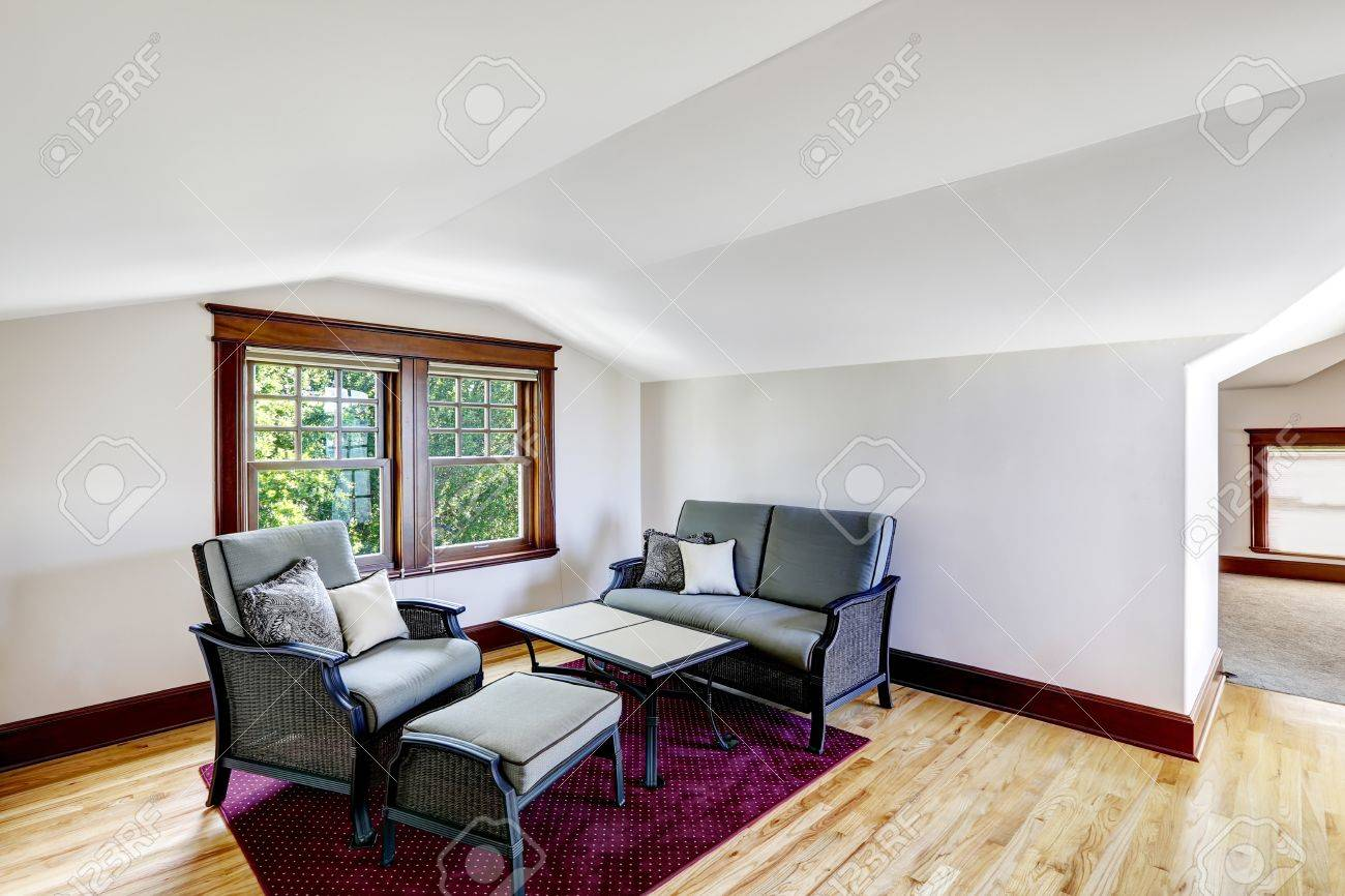 Comfort Sitting Area With Vaulted Ceiling. Couch With Table And ...