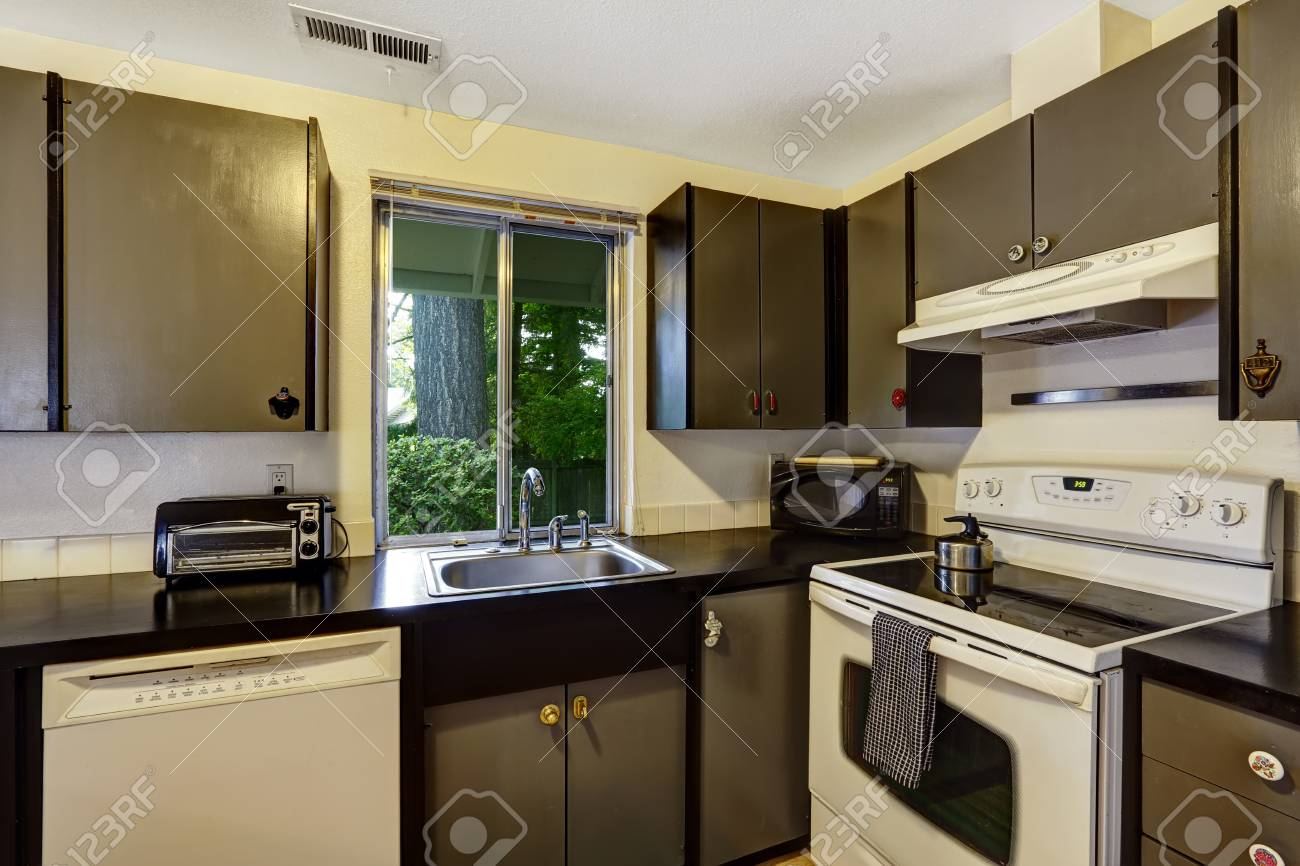 Kitchen Room In Contrast White And Black Colors Black Cabinets Stock Photo Picture And Royalty Free Image Image 31852534