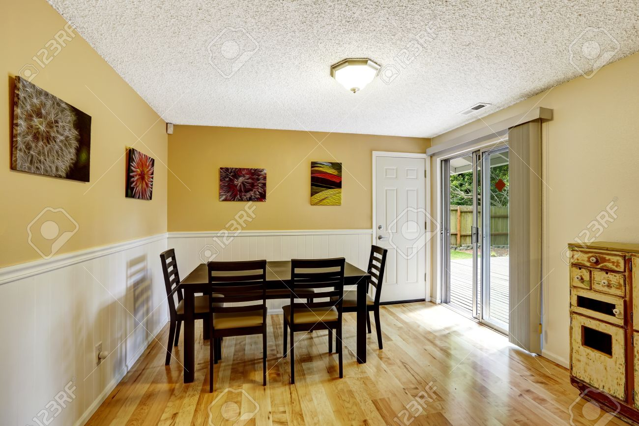 Dining Room With Light Yellow Walls And White Trim. Simple Black ...